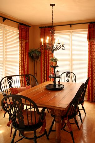 Country Dining Room with Wood dining table, Hardwood floors, Venetian blinds, Kichler portsmouth 5 light chandelier