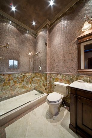 Mediterranean 3/4 Bathroom with Flat panel cabinets, Undermount sink, Stone Tile, High ceiling, frameless showerdoor