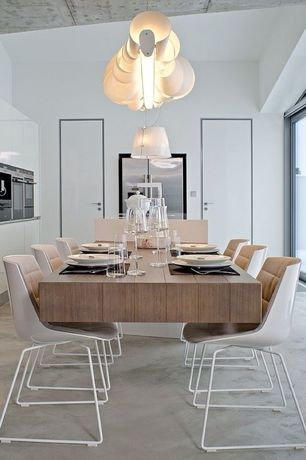 Contemporary Dining Room with Concrete floors, Standard height, picture window, Pendant light, flat door