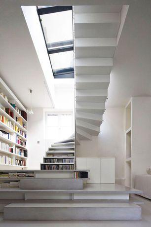 Contemporary Staircase with Laminate floors, Skylight, High ceiling, Pendant light, Built-in bookshelf