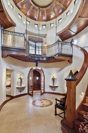 Mediterranean Entryway with Cathedral ceiling, Rotunda, simple granite tile floors, Brushed luxor gold field tile, Foyer