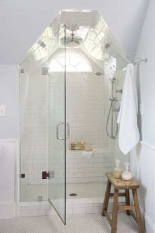 Contemporary Master Bathroom with Arched window, Subway Tile, Wainscotting, Built in shower seat, penny tile floors