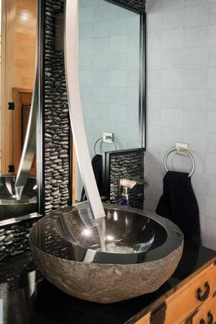 Contemporary Powder Room with European Cabinets, Ceramic Tile, Flush, Signature Hardware Black Granite Boulder Vessel Sink