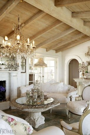 Eclectic Living Room with French doors, Concrete tile , Chandelier, stone fireplace, Exposed beam