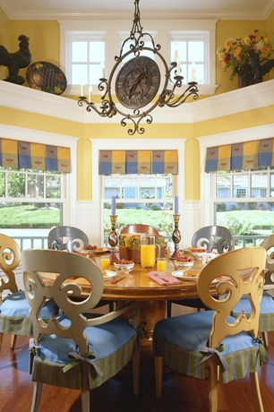 Country Dining Room with Hardwood floors, Built-in bookshelf, Chandelier, double-hung window, Crown molding, Casement