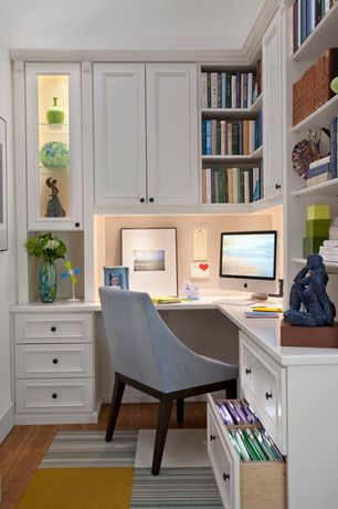 Traditional Home Office with Hardwood floors, Built-in bookshelf, West elm curved upholstered chair, Flor modular carpet tile