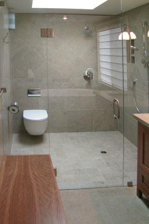 "Contemporary Master Bathroom with Kesir travertine tiles 6"" x 6"" tumbled oasis beige, Freestanding, Master bathroom, Skylight"
