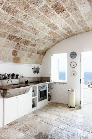 Mediterranean Kitchen with limestone tile floors, Farmhouse sink, stone tile floors, Antique pattern stone tile flooring