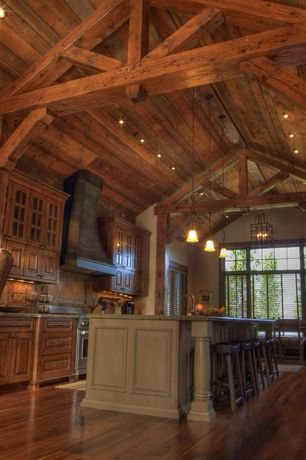 Rustic Kitchen with Custom hood, High ceiling, specialty door, Pendant light, Mini-pendant with mojave glass, Stone Tile