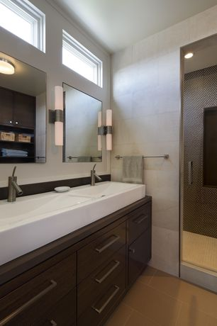 Modern Master Bathroom with limestone tile floors, Wall sconce, flush light