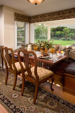 Traditional Dining Room with French doors, Hardwood floors, flush light, Built-in bookshelf