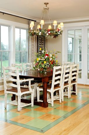 Country Dining Room with double-hung window, Laminate floors, Standard height, French doors, Chandelier