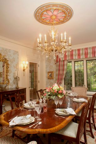 Traditional Dining Room with Standard height, Chandelier, Hardwood floors, Crown molding, interior wallpaper, French doors