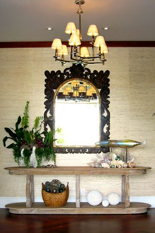 Eclectic Entryway with Chandelier, Hardwood floors, interior wallpaper, Standard height, can lights, Transom window