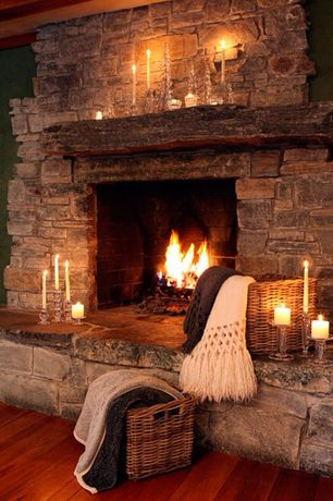 Rustic Living Room with Hardwood floors, Exposed beam, stone fireplace, Stone fireplace surround
