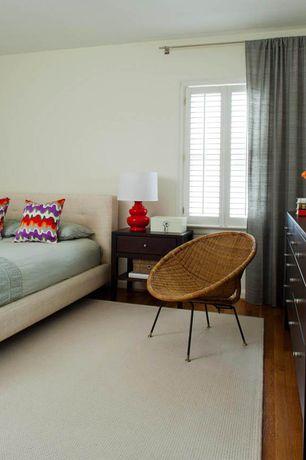 Contemporary Master Bedroom with Built-in bookshelf, Wicker pod chair, Hardwood floors, Throw pillow