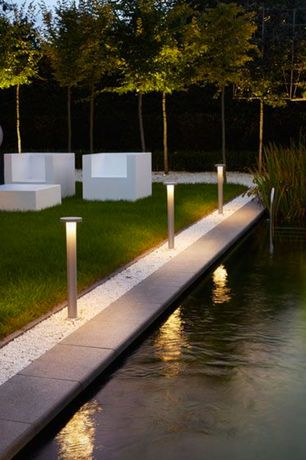 Modern Landscape/Yard with Path lighting, Spooning Armchair, exterior stone floors, Fence, White rock crushed gravel, Pond