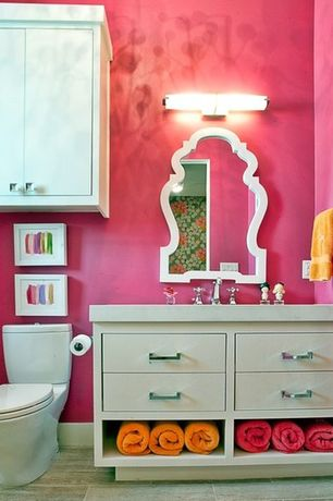 Contemporary Powder Room with European Cabinets, Flush, Pottery barn teen scallop framed mirror, Corian counters