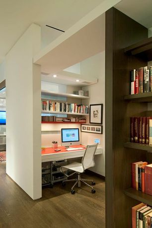 Contemporary Home Office with Built-in bookshelf, Paint 1, can lights, Standard height, Hardwood floors