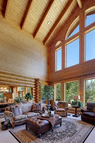 Rustic Living Room with Carpet, Arched window, Cathedral ceiling, Exposed beam