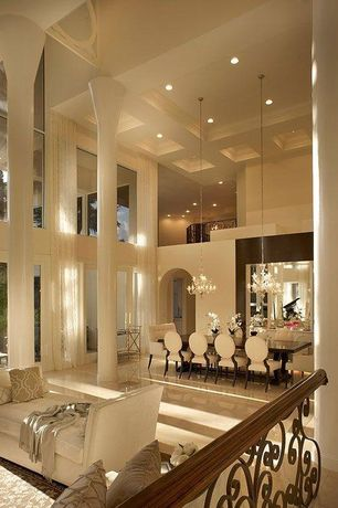 Traditional Great Room with Columns, Loft, High ceiling, Chandelier, Concrete floors