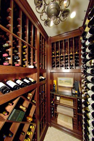 Traditional Wine Cellar with Crown molding, limestone floors, Chandelier