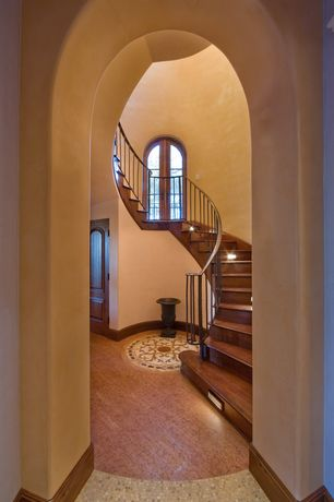 Mediterranean Staircase with Paint, Decorative floor medallion, Cathedral ceiling, Foyer, curved staircase, French doors