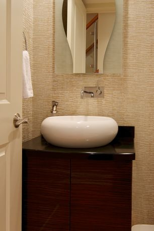 Contemporary Powder Room with specialty door, Hardwood floors, Soapstone counters, partial backsplash, Flush, Vessel sink