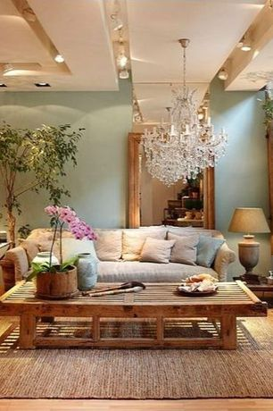 Eclectic Living Room with Built-in bookshelf, can lights, Exposed beam, Standard height, Chandelier, flush light
