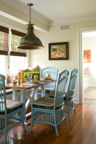 Traditional Dining Room with Paint, Hardwood floors, Crown molding, Pendant light, Casement, Standard height, Window seat