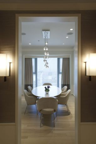 Contemporary Dining Room with specialty window, Laminate floors, Chandelier, Wall sconce, Standard height, can lights