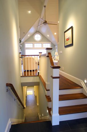 Cottage Staircase with Cathedral ceiling, Ceiling fan, Hardwood floors, curved staircase, Exposed beam