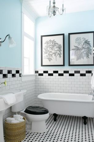Traditional Full Bathroom with Clawfoot, Chandelier, Wall sconce, penny tile floors, Pedestal sink