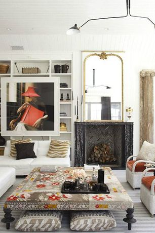 Eclectic Living Room with Cement fireplace, Built-in bookshelf, Pendant light, Carpet