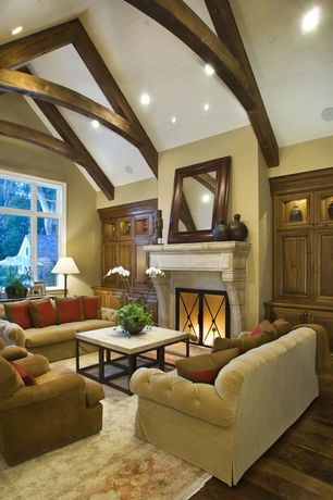 Traditional Living Room with Fireplace, Casement, Cement fireplace, Exposed beam, can lights, High ceiling, Hardwood floors