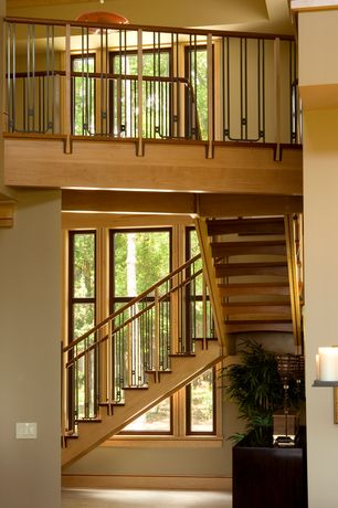 Craftsman Staircase with picture window, curved staircase, Hardwood floors, High ceiling