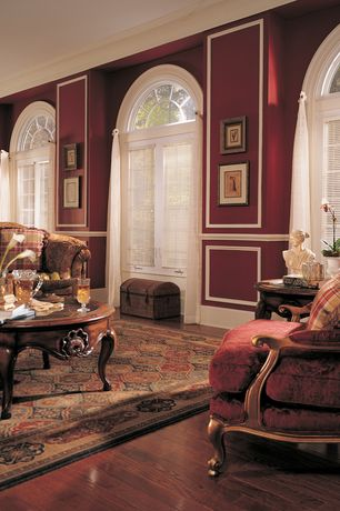 Traditional Living Room with Crown molding, Chair rail, Hardwood floors, Arched window