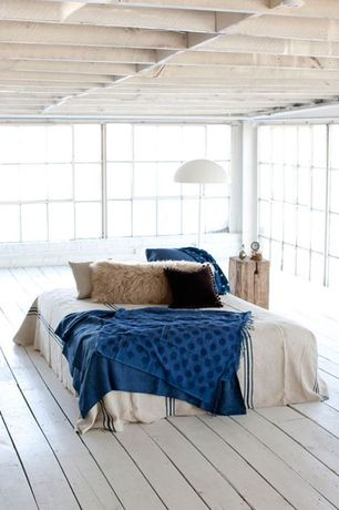Contemporary Master Bedroom with Hardwood floors, Exposed beam, Standard height, picture window