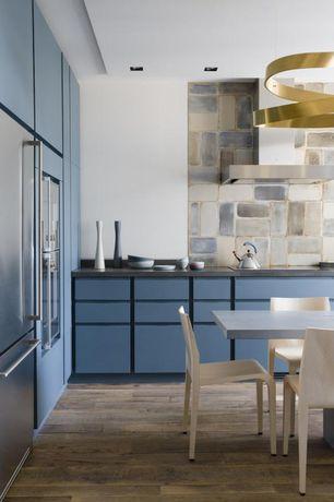 Modern Kitchen with Limestone Tile, Breakfast nook, Reclaimed hardwood flooring, L-shaped, European Cabinets, Stone Tile