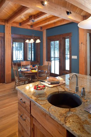 Rustic Kitchen with Undermount sink, Pendant light, Breakfast nook, Flat panel cabinets, Amana round pedestal dining table