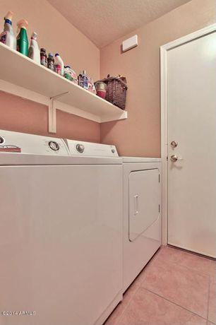 Traditional Laundry Room with Undermount sink, travertine tile floors, flat door, Standard height, Paint, Built-in bookshelf