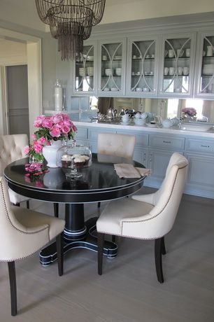 Traditional Dining Room with Wilsonart - Coconut Oil, Built-in bookshelf, Standard height, Chandelier, Paint 1, Paint 2