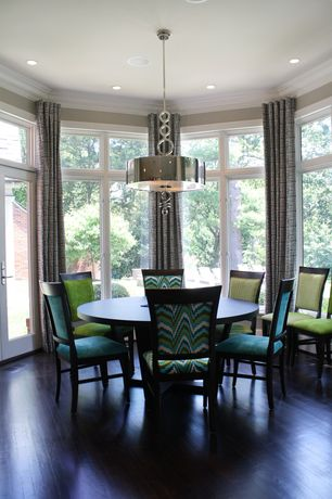 Contemporary Dining Room with Crown molding, French doors, Pendant light, Transom window, Hardwood floors