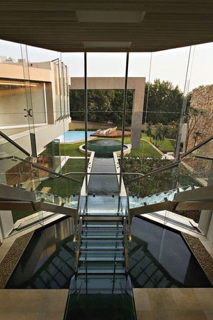 Modern Staircase with Glass staircase, Double staircase, Cathedral ceiling