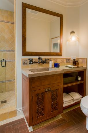 Mediterranean Full Bathroom with Standard height, Limestone counters, Wall sconce, Full Bath, Crown molding, Shower
