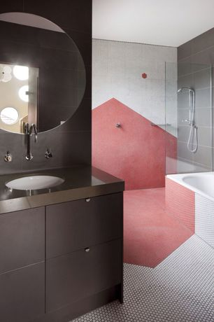 Contemporary Full Bathroom with Flush, penny tile floors, European Cabinets, Handheld showerhead, Soapstone counters