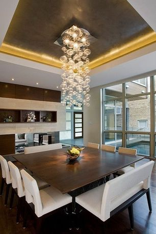 Contemporary Dining Room with Built-in bookshelf, can lights, Sunpan Modern Element Side Chair, Chandelier, High ceiling