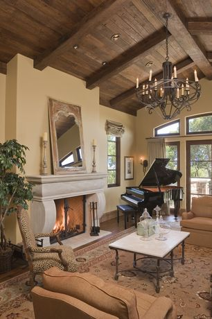 Mediterranean Living Room with Wall sconce, Chandelier, picture window, Cement fireplace, High ceiling, Casement, Fireplace