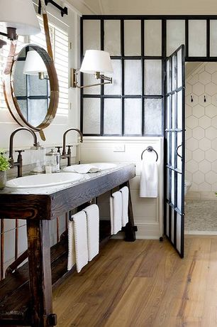 "Rustic Master Bathroom with specialty door, EliteTile Hexitile 8"" x 7"" Porcelain Glazed Tile in Matte White, Wall sconce"