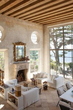 Mediterranean Living Room with picture window, Paint 1, stone fireplace, Wall mirror, flush light, specialty window